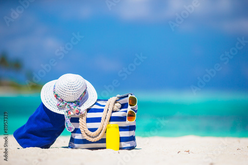 Blue stripe bag and towel, straw white hat, sunglasses - 81957339