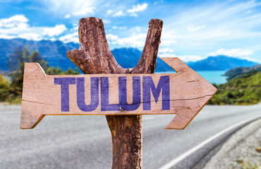 Tulum wooden sign with road background