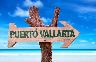 Puerto Vallarta wooden sign with beach background