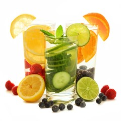 Group of glasses of healthy detox water with fruit over white