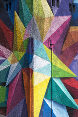 Colorful Graffiti detail on the textured wall