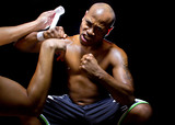Fotoroleta Fighter or Boxer with trainer applying athletic tape