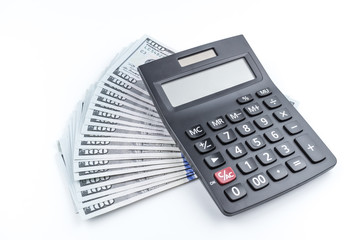 Money and calculator on white