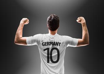 German soccer player on black background