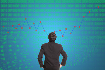 Businessman looking growing graph