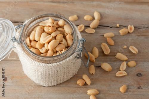 Fotobehang Assortiment raw peanuts in glass jar