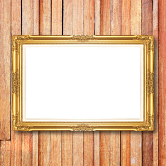 antique gold frame on wooden wall
