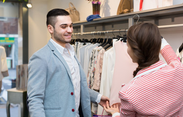 Young couple in clothing store