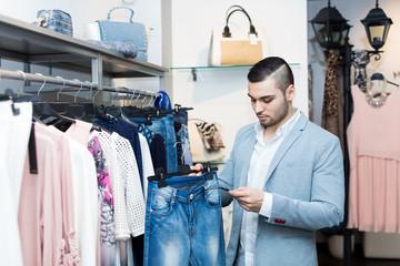 man choosing new female garment