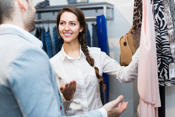 Customer consulting with shop assistant