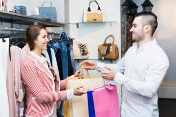 Store clerk serving purchaser