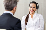 Female Customer Service Representative Looking At Manager In Off