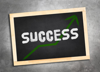 success word and green upper arrow on blackboard lay on grunge c