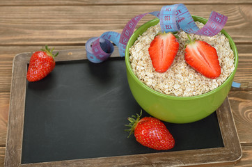 Oatmeal, strawberries and measuring tape