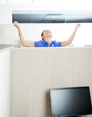 Customer Service Representative Celebrating Success In Cubicle
