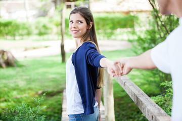 Woman Holding Hand Of Boyfriend