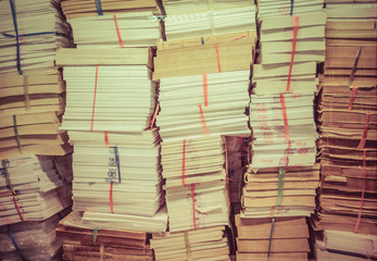 stack of old books and documents in retro color