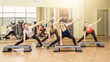 Group of women making step aerobics - 81969191