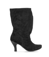 black suede high-heeled boots isolated on a white background