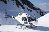 White rescue helicopter parked in the mountains