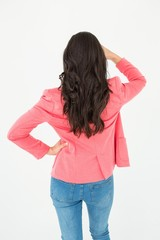 Elegant brunette standing back to camera and looking away