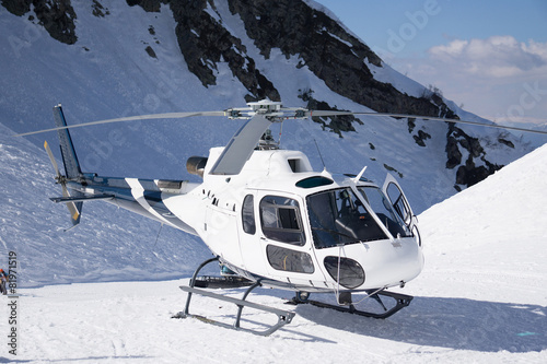 Foto op Canvas Helicopter White rescue helicopter parked in the mountains