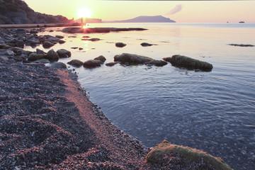 sunrise on the pebbly coast