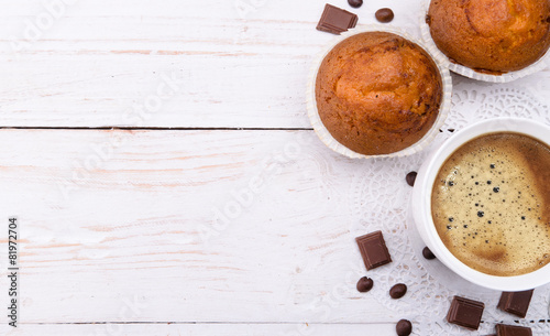 Aluminium Cafe Coffee cup with a muffin . Background.
