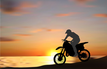 man on motorcycle near sea at sunset
