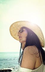 Latin woman in the beach