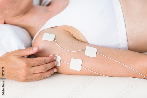 poster of Woman having electrotherapy