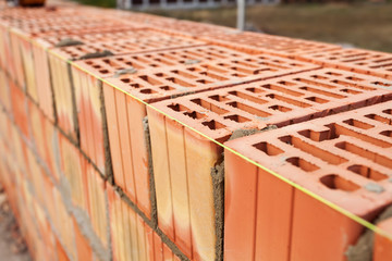 Laying bricks with a guideline