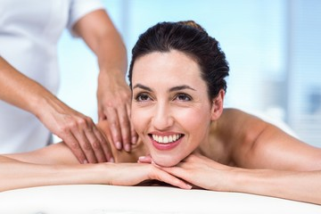 Smiling brunette getting back massage