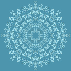 Round ornate pattern on blue background