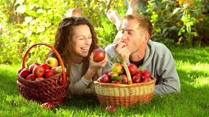 Happy Couple Eating Apples