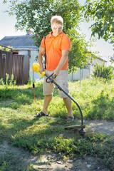 man mows a lawn mower