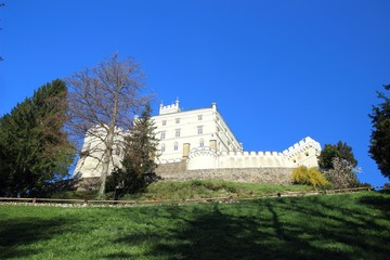 Castle on the hill and blue sky in background