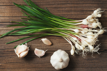 Healthy spring young garlic on vintage background. Rustic style.