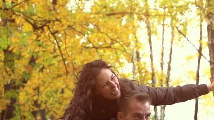 Autumn. Happy Couple Having Fun Outdoors