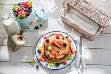 American pancakes with maple syrup and fruits