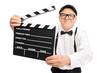 Senior movie director holding a movie clapper