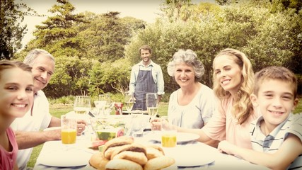 Happy extended family waiting for barbecue