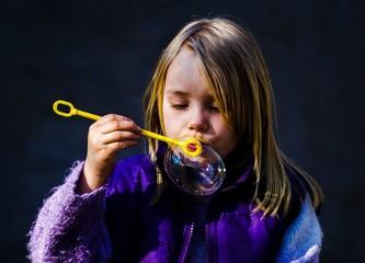 Girl blow soapbubble