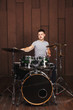 Drummer on a brown background - 81980167