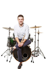 Man sits on drums