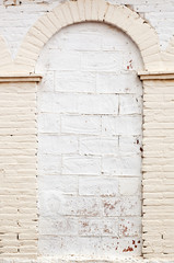 White brick wall with arch