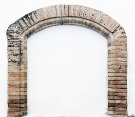 White wall behind brick arch