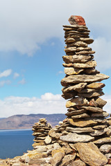 Lake Baikal. High stone pyramid on rocky shore