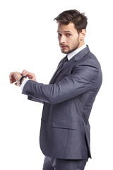 young business man  looking at watch over white background