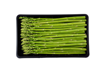 fresh green asparagus on tray with white background